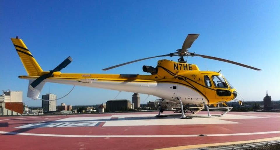 Yellow Airbus AS-350 B3 aerial crane available from Helicopter Express.