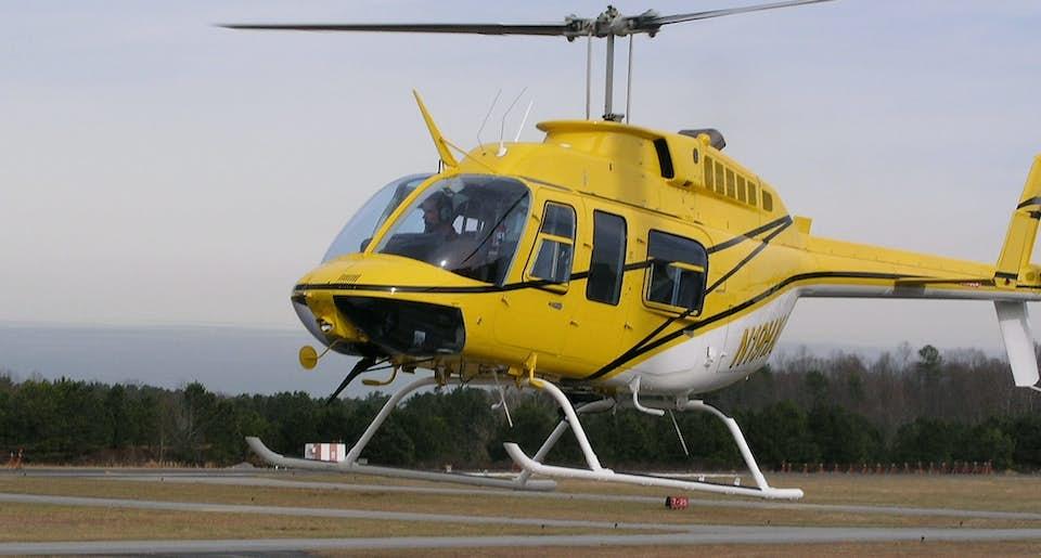 Bell 206 L-3 on a landing strip