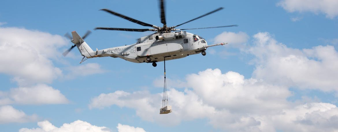 How Aerial Crane Helicopters Suspend, Support and Hoist Utility and Construction Cargo