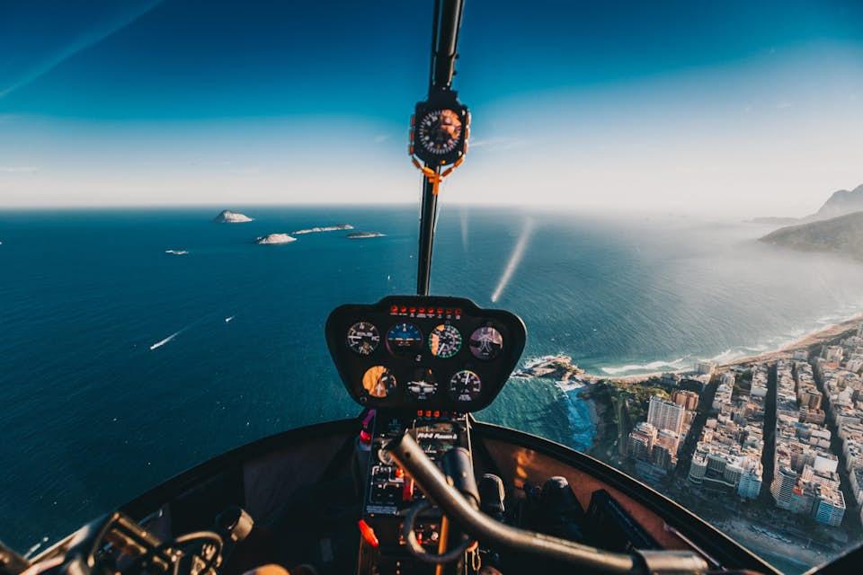 inside helicopter above ocean and breathtaking landscape