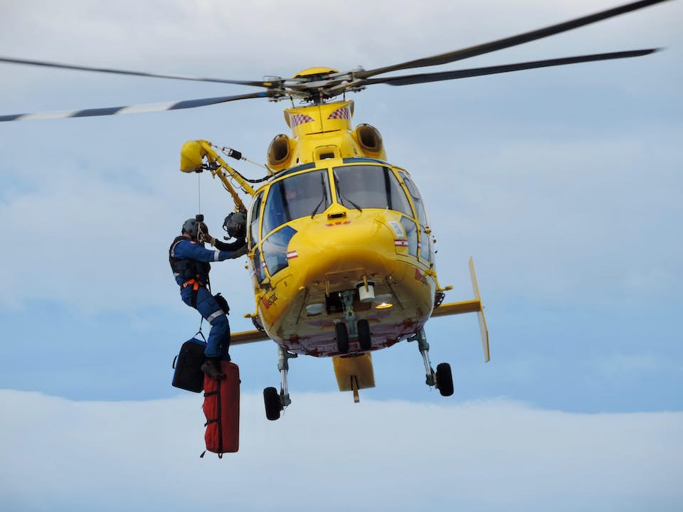 Search and rescue helicopter delivering disaster relief aid.