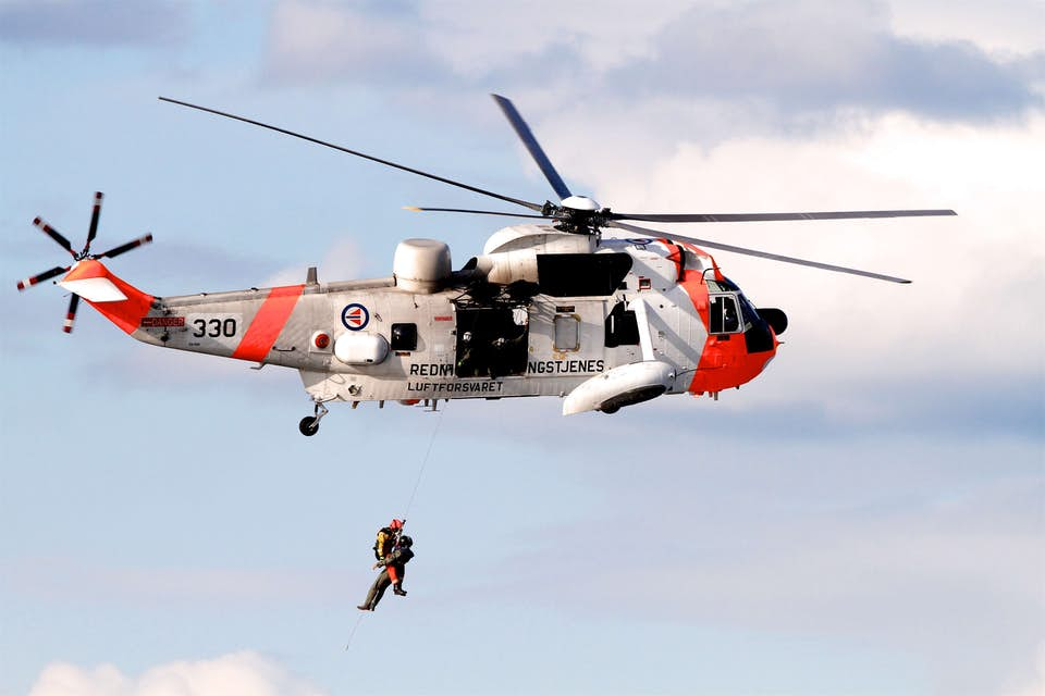 Search and rescue helicopter performs an aerial rescue